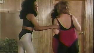 Erotic interracial brunettes in their pantyhose love flex in the gym in a retro action