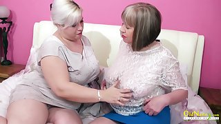 Oversexed mature lesbian George Gina gives a cunnilingus to aged girlfriend